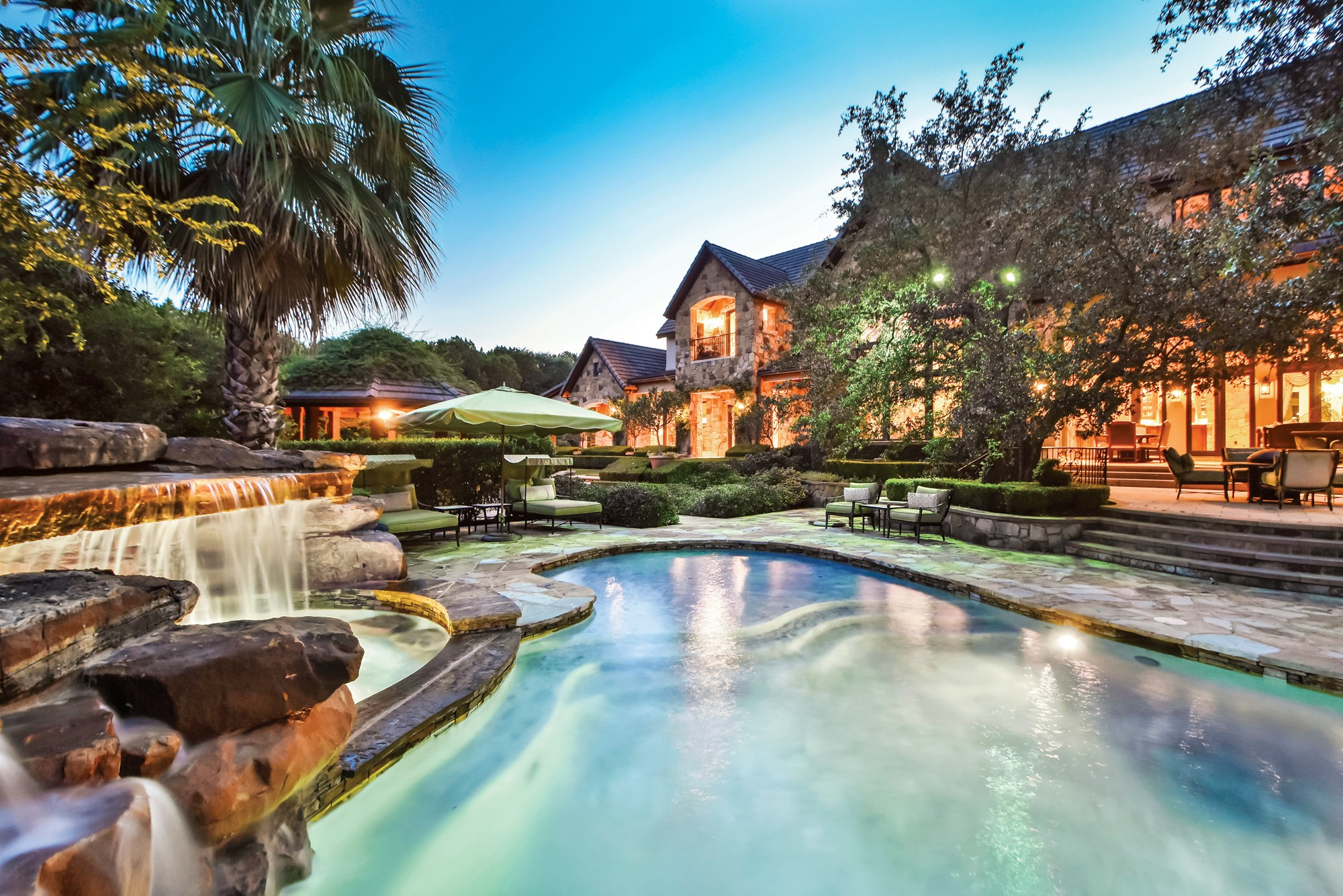 Discretely located adjacent to the 18th hole of the Austin Country Club in the hills of Capital of Texas Highway